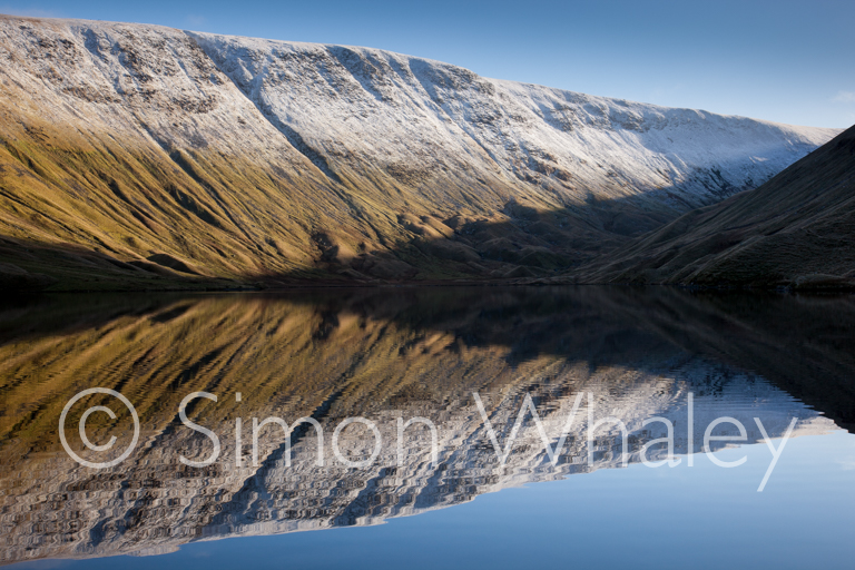 High Street reflected in Hayeswater near Hartsop, Lake District,
