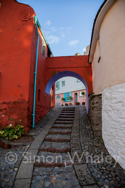 A pathway towards an archway at Portmeirion Village, near Portma