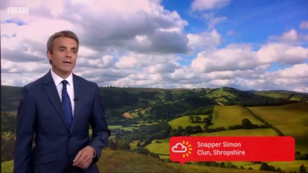 John Hammond using one of Snapper Simon's photos on the Six o'clock News national weather forecast